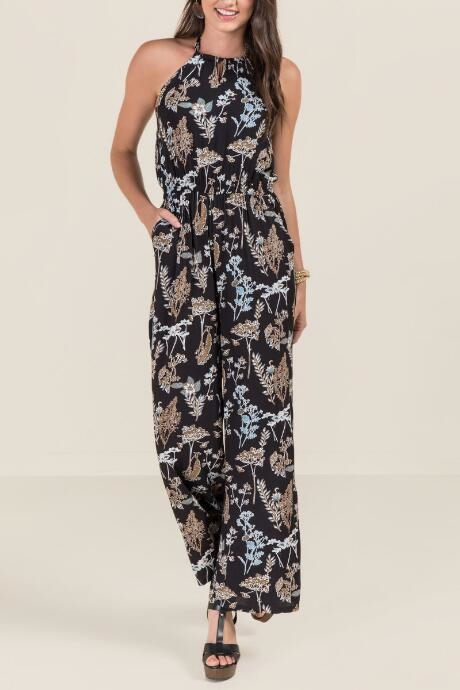 The Dawn Floral Jumpsuit features a high neck and an open back.