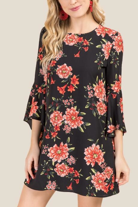 The Kaya Floral Bell Sleeve Shift Dress features an open back and bell sleeve detail which are an update to the shift dresses.