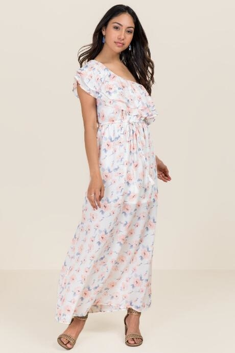 The Helena One Shoulder Floral Maxi Dress features ruffle detail and a white grounded floral print.