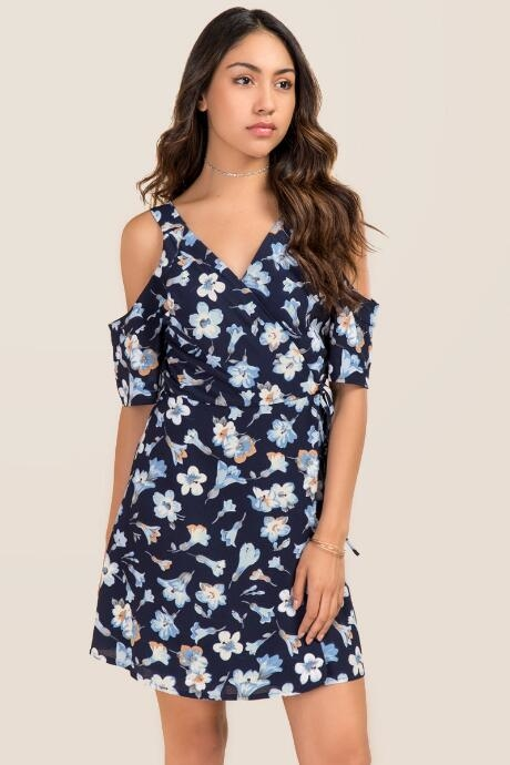 The Maisie Cold Shoulder Floral Wrap Dress features a tie waist.