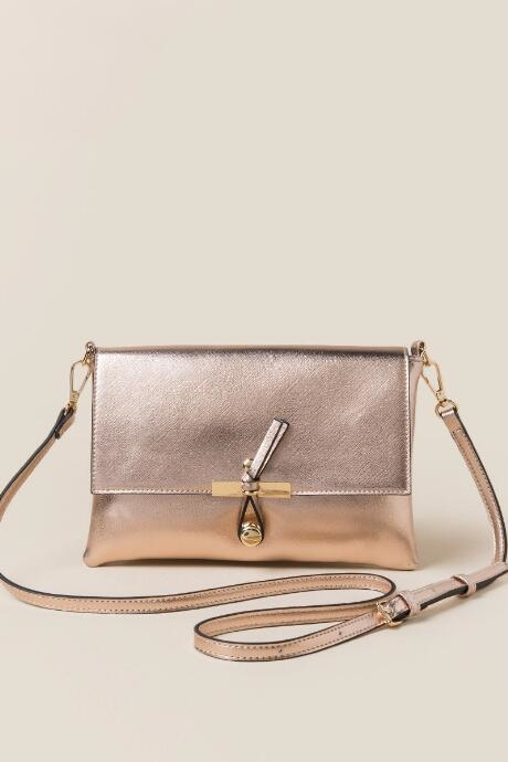 The Joy Metallic Hook Crossbody features brushed gold metal and saffiano leather in rose gold.
