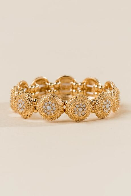 The Renia Circle Stretch Bracelet features textured gold metal and opal stone inserts.
