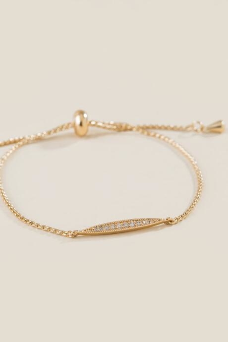 The Addyson Pull Tie Bracelet is a delicate pull tie bracelet in gold with pave accents.