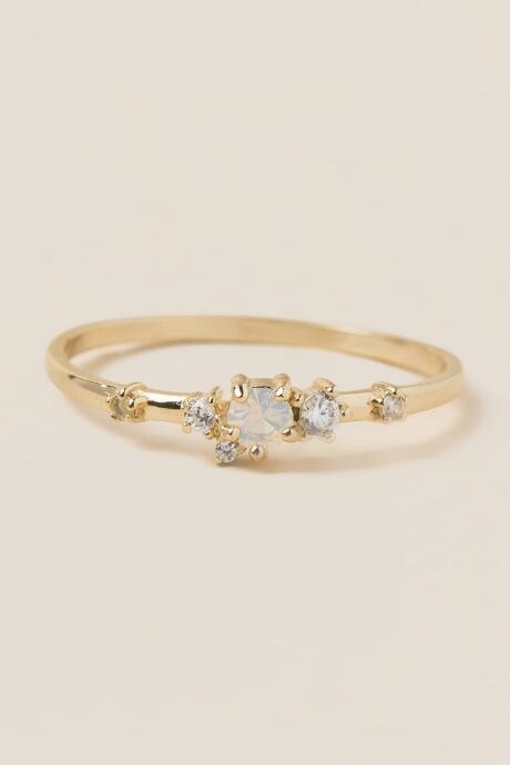 The Emma Crystal Cluster Ring is a sterling silver coated in 14k gold cubic zirconia delicate stacking ring.