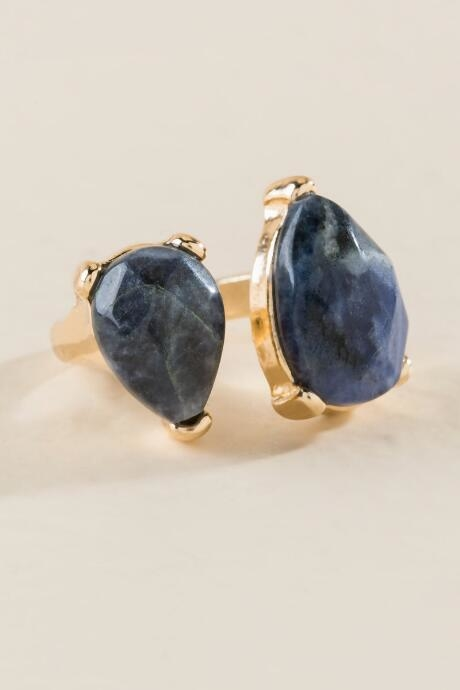 The Willow Lapis Statement Ring is a gold metal semi precious teardrop stone ring in blue.