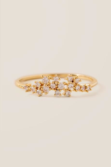The Jorja Cubic Zirconia Cluster Ring features a delicate gold band.