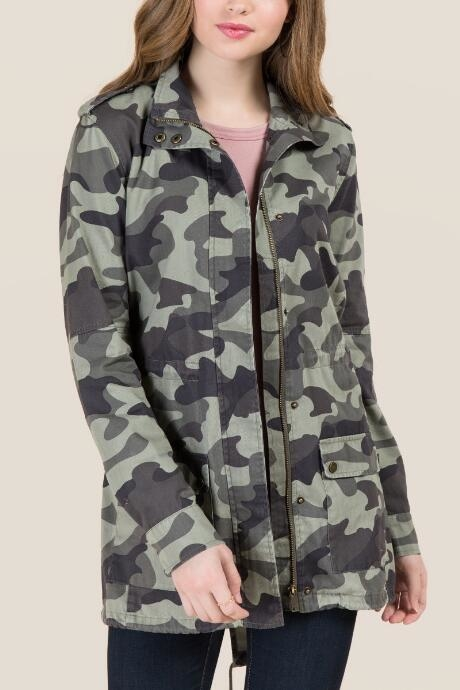 The Roslyn Long Sleeve Camo Anorak features all over camo print with front pockets.