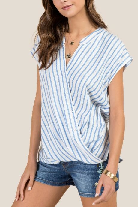 Elena Striped Button Down Blouse is a surplus blouse with buttons in the front.