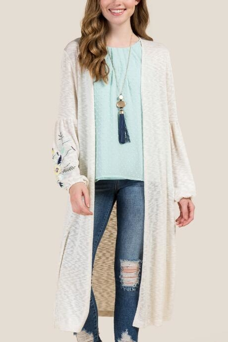 The Joslyn Embroidered Poet Sleeve Cardigan features a duster length.