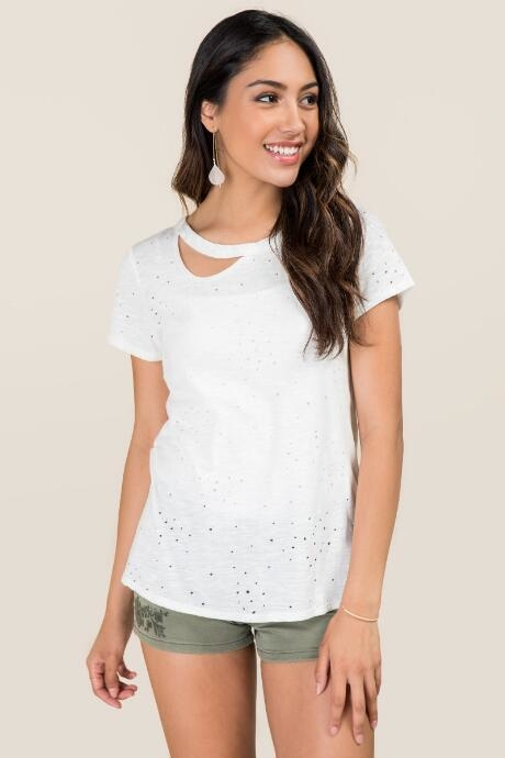 The Eadie Single Cut Out Distressed Knit Tee features a single cut out along the neckline which is an update to the knit tee.