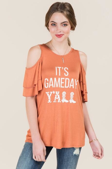 The It's Gameday Y'all Double Ruffle Graphic Tee features a ruffle cold shoulder sleeve which is an update to the graphic tee.