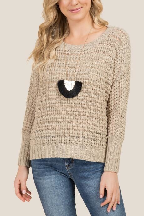 The Vale Textured Dolman Pullover Sweater features a crew neckline.