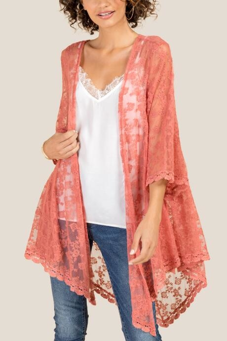 The Tria Embroidered Lace Kimono features a delicate pattern.