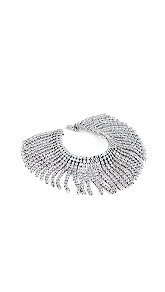 Add a rock-star finish to your look with this crystal-fringe Marc Jacobs bracelet. Crystal detailing Bangle bracelet Hinged clasp at side Imported, China Measurements Width: 1.75in / 4.5cm Length: 6in / 15.5cm