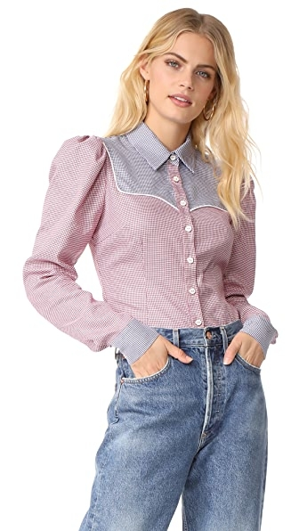 Two-tone houndstooth shirting lends a crisp element to this western-style Caroline Constas shirt. Button placket. Long sleeves and button cuffs. Fabric: Houndstooth shirting. 100% cotton. Dry clean. Made in the USA. Measurements Length: 23.5in / 60cm, from shoulder Measurements from size S