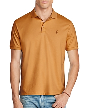 Polo Ralph Lauren's Soft Touch polo shirt has been specially treated to give it a lustrous, refined appearance and an ultra-soft feel. Best of all, the collar and armbands are constructed to retain their fit even after multiple washes. (Clearance)