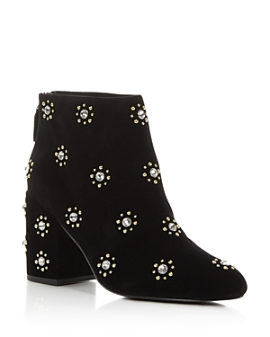 Faux-suede booties get a modern update with allover stud details. Pointed toe and side zipper closure.