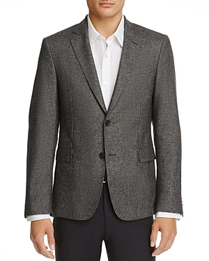 Featuring a slim silhouette and plenty of texture, this sport coat from Boss Hugo Boss adds a versatile collegiate vibe to your collection.