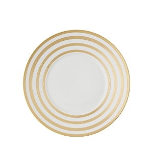 Bright 24K gold rings lend dimension and texture to vivid white dinnerware from Jl Coquet. Hand-sculpted matte exteriors are softly contrasted by glossy glazed interiors.