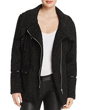 Statement fuzzy texture takes the front seat on this faux fur moto jacket from Sunset + Spring, trimmed in faux leather and cut in a cool oversized silhouette. Only at Bloomingdale's.