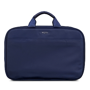 Organize cosmetics and other travel accessories for journeys of any length with this triple-compartment travel kit from Tumi.