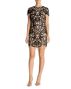 Luxe sequin embellishments in a dramatic damask motif dial up the glam factor of this illusion mini from Dress the Population.