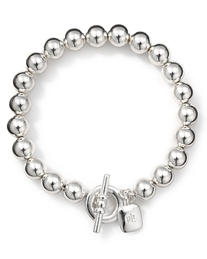 Take your jewel box in a classic direction with Lauren Ralph Lauren's toggle bracelet. In sterling silver plate, this strand is an essential asset to every wardrobe.