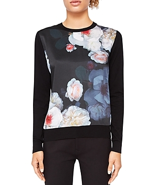 Give your everyday wardrobe an instant upgrade with this crewneck sweater from Ted Baker, defined by a contrasting floral-print front with undeniable feminine charm.