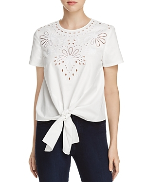 Intricate eyelet embroidery and a knotted tie front charm this sweet cotton top from Catherine Catherine Malandrino.