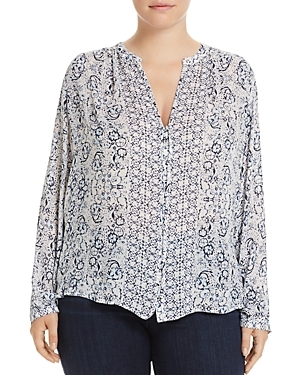 A muted floral motif, smocked back and button-loop detail lend a pretty-meets-pastoral vibe to this flowy blouse from Lucky Brand Plus.