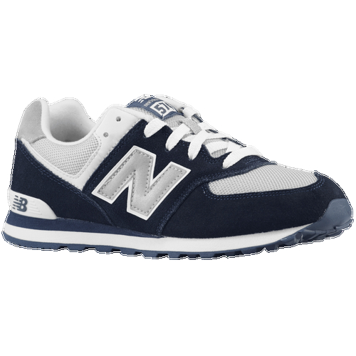 Step into comfort in these boys' New Balance 574 sneakers. Designed with advanced cushioning technology in the midsole the sneakers will keep you moving with ease all-day long. Street-savvy style comes in the form of suede upper with streamlined construction and a clean finish. Suede and mesh upper permits breathability keeping your feet dry. Padded collar and tongue provides support and a snug fit. ENCAP technology gives you the utmost comfort and flexibility. TPU heel insert adds support and stability. EVA and polyurethane midsole create lightweight shock-absorption. Rubber outsole enhances durability and traction.