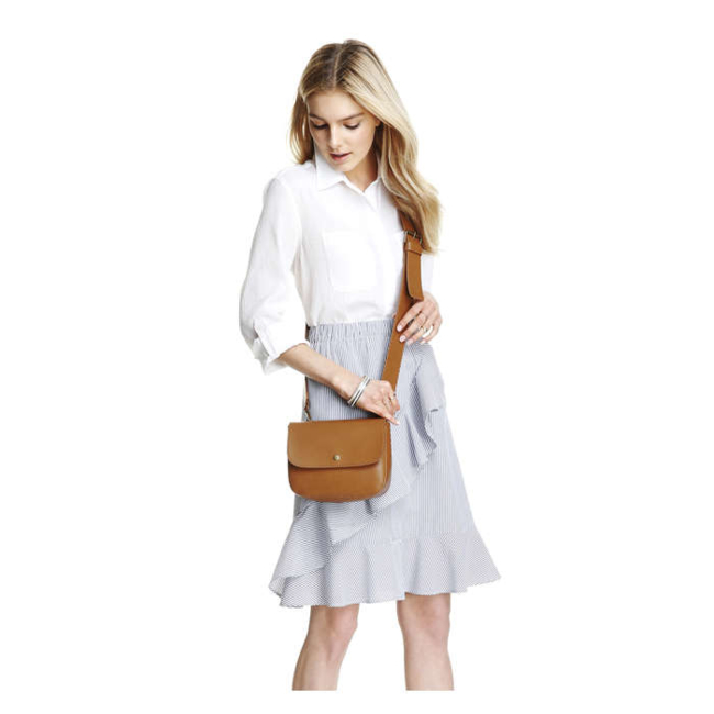 Women / Accessories / Bags / Reach for this fall classic with a twist. The straps on our latest bag detach, so you can use it like a clutch. Faux leather cross body bag / Button closure / Detachable straps / 6 H x 8 W x 2.5 D / Faux Leather, 100% polyurethane