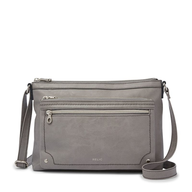 This Relic crossbody bag is the perfect size for all your daily essentials. Handbag Features Adjustable strap Silver-tone hardware Handbag Details 7.6H x 11W x 2.25D Approx. drop down length: 24 Exterior: 2 zip pockets Interior: zip pocket & 2 slip pockets Faux leather Size: One Size. Color: Yellow. Gender: Female. Age Group: Adult. Pattern: Solid.