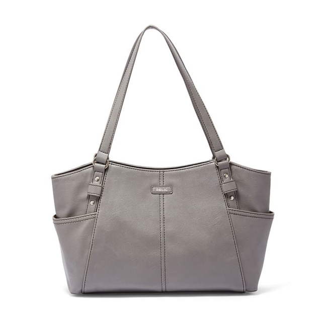 This Relic shoulder bag is all about style with its simple and sleek design. Handbag Features Paneled design Silver-tone hardware Handbag Details 10H x 16.5W x 3.5D Drop down handle length: 10 Shoulder straps Magnetic snap closure Exterior: 2 slip pockets Interior: center zip compartment, zip pocket & 2 slip pockets Faux leather Style no. RLH8330 Size: One Size. Color: Yellow. Gender: Female. Age Group: Adult. Pattern: Solid.
