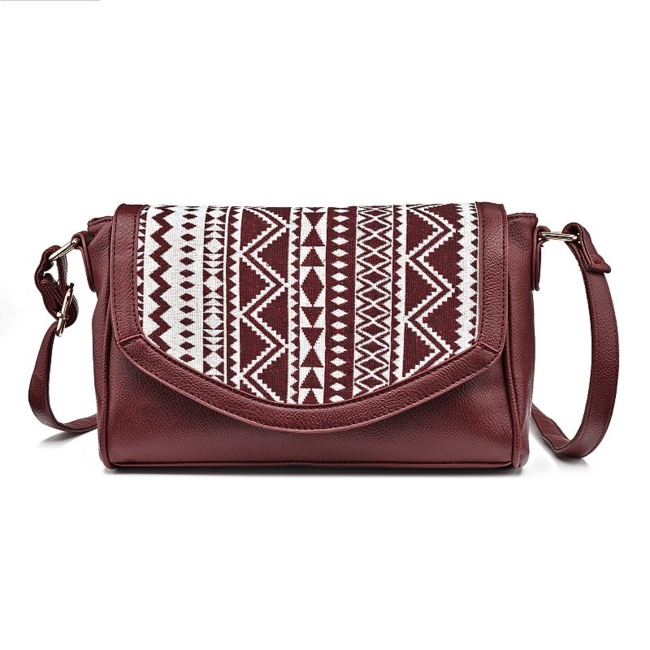 The tribal pattern of this Olivia Miller crossbody bag gives you laid-back style, year round. Handbag Features Tribal pattern on front Handbag Details 7H x 10.5W x 3.5D Approx. drop down length: 23.5 Adjustable crossbody strap Zipper closure Exterior: zip pocket Interior: zip pocket & 2 slip pockets Faux leather, polyester Style no. OMZ-0276 Size: One Size. Color: Red. Gender: Female. Age Group: Adult. Material: Faux LeatherFabric.