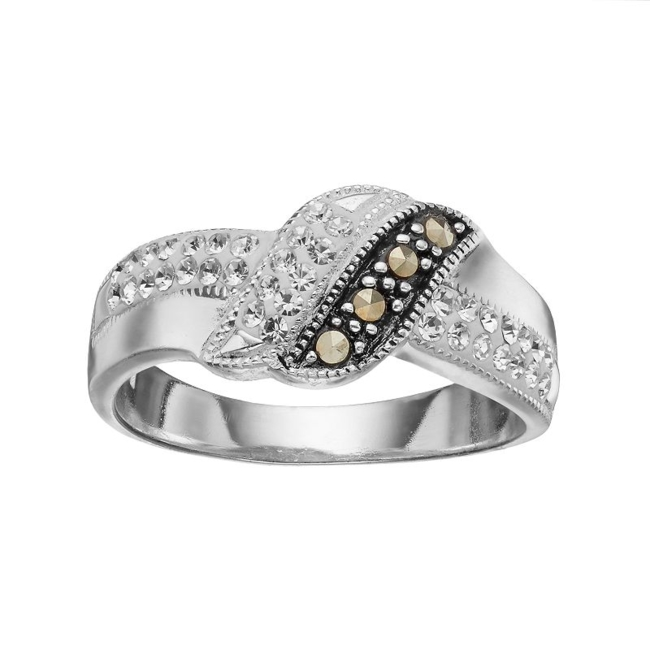 Your style will be unmatched when you wear this fanciful marcasite and crystal ring. Ring Details Width: 9.65 mm Metal: brass Plating: silver Size: 6. Color: Grey. Gender: Female. Age Group: Adult. Material: Silver PlateBrass.