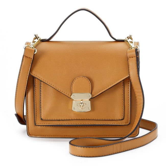 Update your look with this Mellow World crossbody bag, a must-have modern accent. Handbag Features Gold-tone hardware Included dust bag for storage Handbag Details 7H x 8W x 3D Top handle: 2 drop Removable/adjustable crossbody strap: 22 approx. drop Flap closure with turn lock Exterior: slip pocket Interior: 3 slip pockets & zip pocket Faux leather Size: One Size. Color: Yellow. Gender: Female. Age Group: Adult.