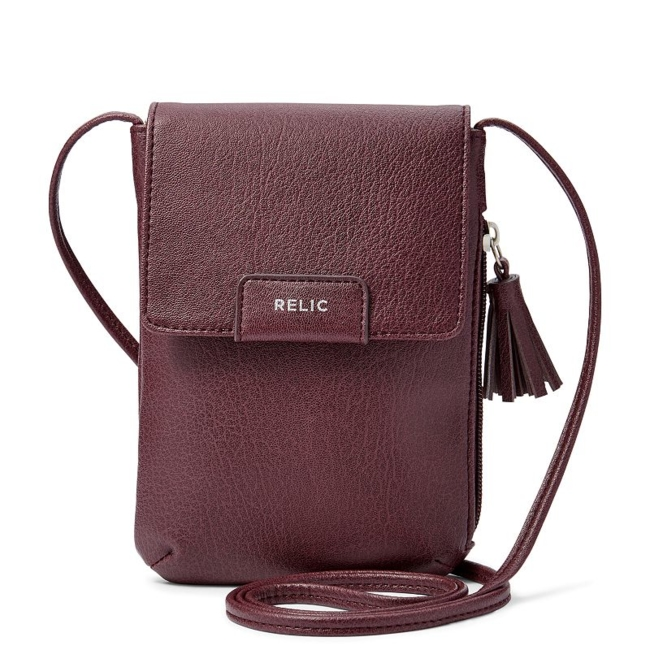 A perfect fit for all your daily essentials, this Relic crossbody bag includes a phone pocket. Tassel embellishment 5H x 1W x 6.87D Crossbody strap: 26 approx. drop Silver-tone hardware Snap closure Exterior: zip pocket & slip pocket Interior: main compartment & slip pocket Fabric & Care Faux leather Polyester lining Wipe clean Imported Size: One Size. Color: Purple. Gender: Female. Age Group: Adult.