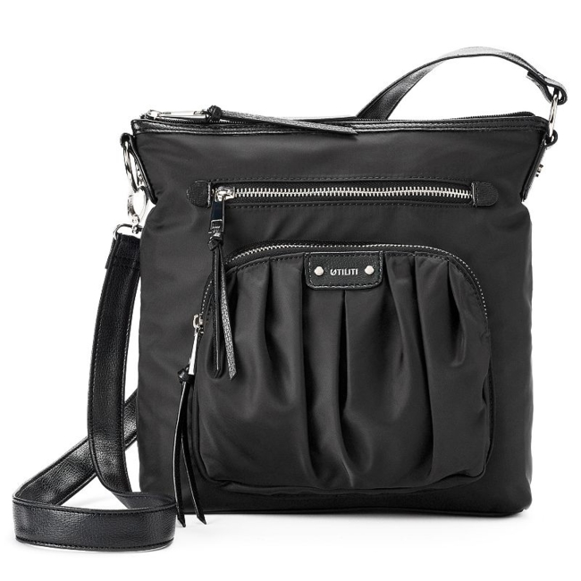 This versatile women's crossbody bag from Utiliti features a shoulder strap that quickly converts to an easy-to-carry handle to give you options for accessorizing. Convertible strap design 11H x 9.5W x 2.88D Convertible shoulder strap: 10-21.5 drop Silver-tone hardware Zipper closure Exterior: 3 zip pockets & slip pocket Interior: main compartment, zip pocket & 4 slip pockets Fabric & Care Nylon Polyester twill lining Wipe clean Imported Size: One Size. Color: Black. Gender: Female. Age Group: Adult.