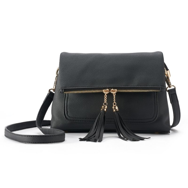 Elevate your look with this eye-catching crossbody bag. Tassel zipper pulls Protective metal feet Included dust bag for storage 7H x 9.5W x 3.5D Removable crossbody strap: 19.5-22.5 drop Snap button and zipper closure Gold tone hardware Exterior: 2 zip pockets, snap pocket Interior: 2 main compartments, zip pocket, slip pocket Fabric & Care Faux leather & polyester Wipe clean Imported Size: One Size. Color: Natural. Gender: Female. Age Group: Adult. Material: Pvc.