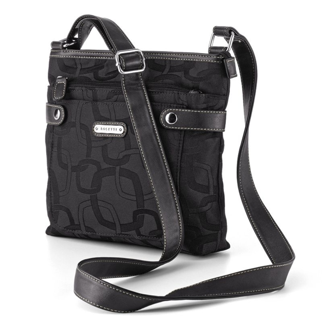 Silver-tone hardware provides the perfect finishing touch. 9H x 9W x 2 1/2D Approximate drop down length: 16 Zipper closure Adjustable crossbody strap Exterior: slip pocket & zip pocket Interior: 2 slip pockets & zip pocket Fabric/faux leather Style no. 31038KL Size: One Size. Color: Black. Gender: Female. Age Group: Adult. Pattern: Geometric.