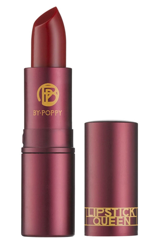 What it is: Lipstick Queen founder Poppy King created this lipstick to mimic medieval times, where lipstick was considered a sin and women used the natural acidity of lemons to bring forth a natural blood-red stain on their lips. What it does: Made purely with vitamin E and pigment, this silky lipstick is divinely transparent, and best of all, it makes your skin look flawless. It's the perfect alternative to a lip gloss without being a full-coverage lipstick. Its sheer, sexy hint of red gives your lips that just-bitten look. How to use: Apply straight from the bullet. Style Name: Space. nk. apothecary Lipstick Queen Medieval Lipstick. Style Number: 586049. Available in stores.