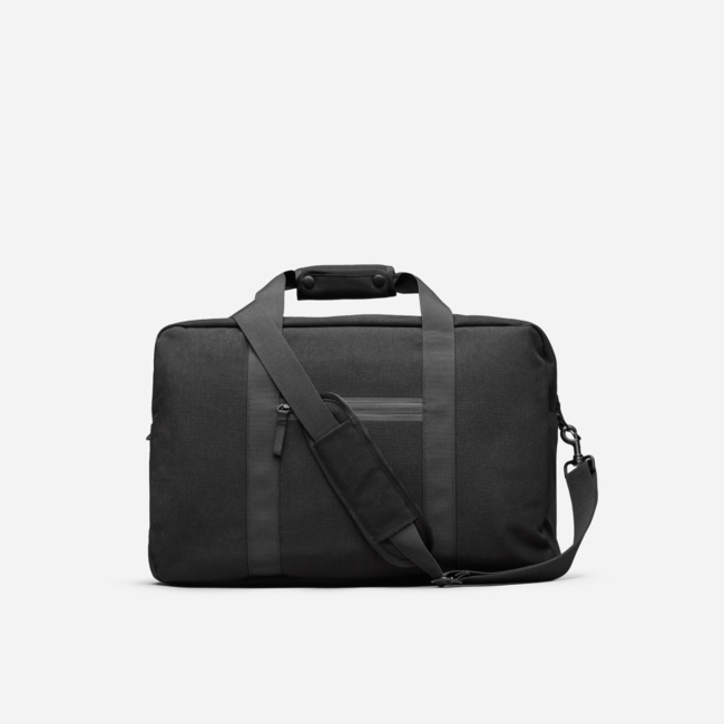 A better weekend bag. Made of durable nylon bonded with a TPE backing for water resistance and complete with bonded and taped zippers for extra weather protection. Form meet function. Women's Nylon Weekender Bag by Everlane in Black