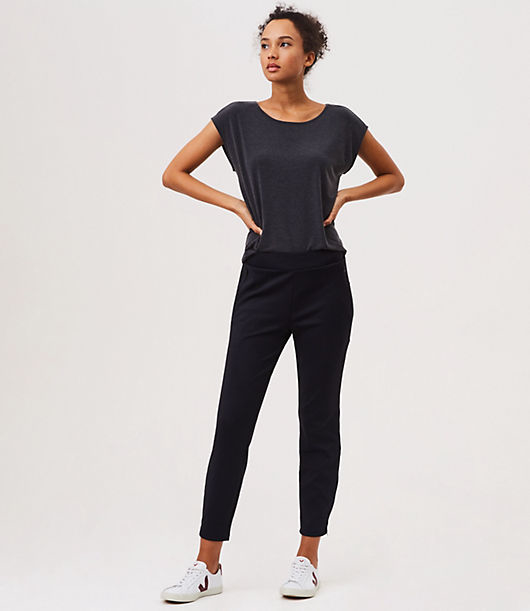 Drapey yet structured, this pair is anytime wear - made for warming up, cooling down and chilling out. Hidden inside drawstring waist. Zip pockets. Curved back yoke. Outer ankle zippers. 26 1/2inch inseam.