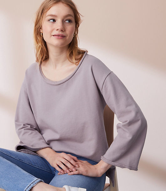 In a stroke of genius, we merged favorite tee styling with pure cotton terry to get this sweatshirt-inspired must have. Round neck. 3/4 bell sleeves.