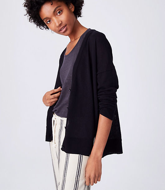 In 2014, we made a commitment to empower women working in our global supply chain community by giving them access to financial education, health information, and more. This piece was made by the women of HERproject. In the breeziest linen and cotton blend, this lightweight cardigan outlines your style in effortless cool. V-neck. Long sleeves. Drop shoulders. Button front. Side slits.