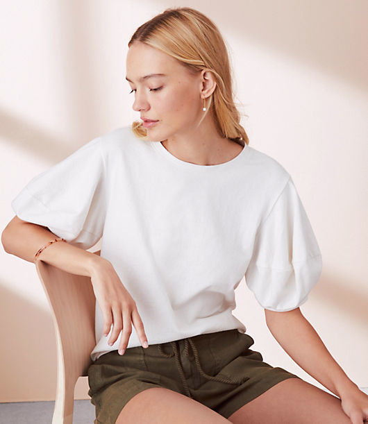Merging pretty puff sleeves with all the feel of your fave cotton sweatshirt, this tee is the sweetest treat. Round neck. Short sleeves.