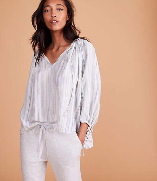 Styled with delicate striped and ties, this airy top wraps up your look - effortlessly. Split neck with ties. 3/4 sleeves with tie cuffs.