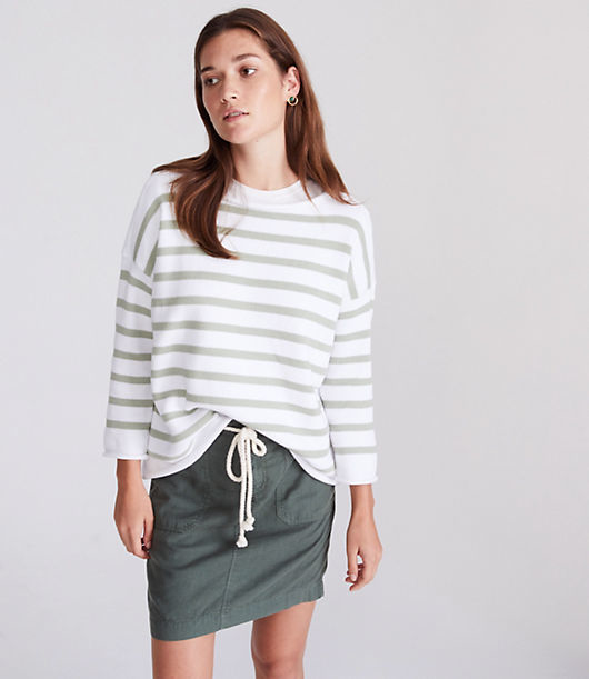 Effortlessly styled with a delicate rolled neck, cuffs and hem, this striped sweater has all the right moves. Round neck. 3/4 sleeves.