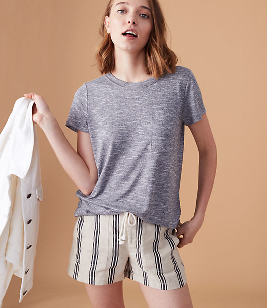 We love the sporty sweet vibe of this perfectly soft and drapey knit - finished with the cutest patch chest pocket. Round neck. Short sleeves.